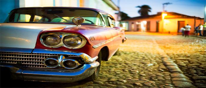 Cuba classic car cobbled street