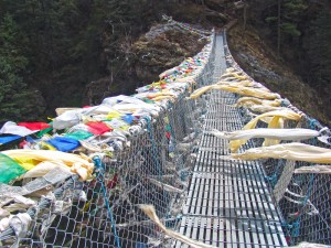 Crossing a prayer flag laden bridge