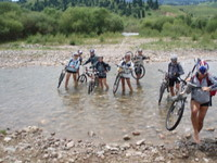 Kazakhstan and Kyrgyzstan MTB crossing a river