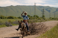 Kazakhstan and Kyrgyzstan MTB riding a pony