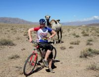 Cycle Pakistan Kyrgzstan China camel and cyclist
