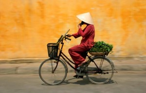 Indochina heritage tour Vientamese monk riding a bike