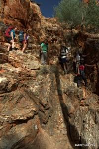 Climbing down the dry waterfall